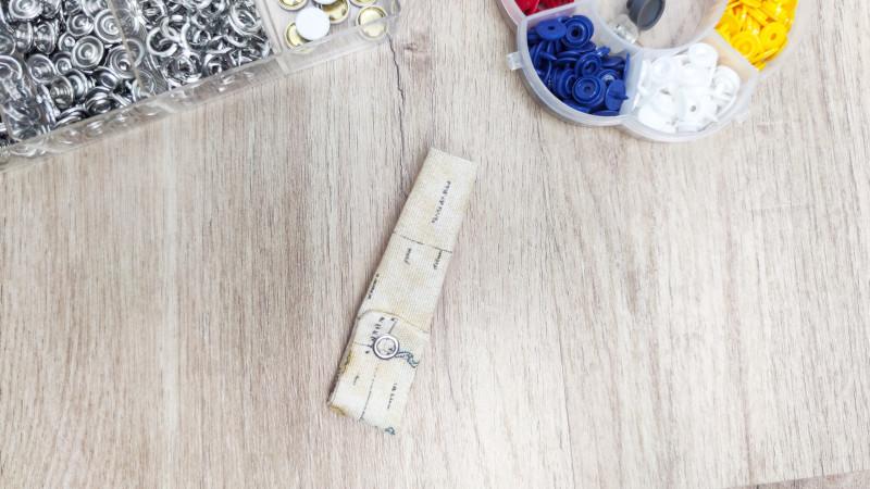 windeltasche-naehen-schnullerband-mit-knopf